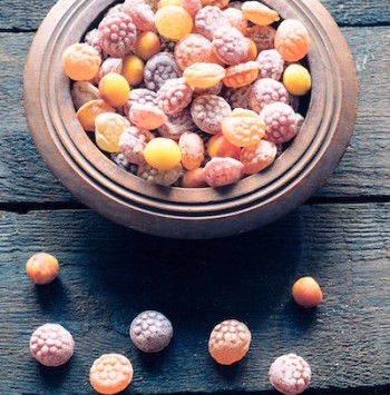Colorful bonbons on wooden background,selective focus
