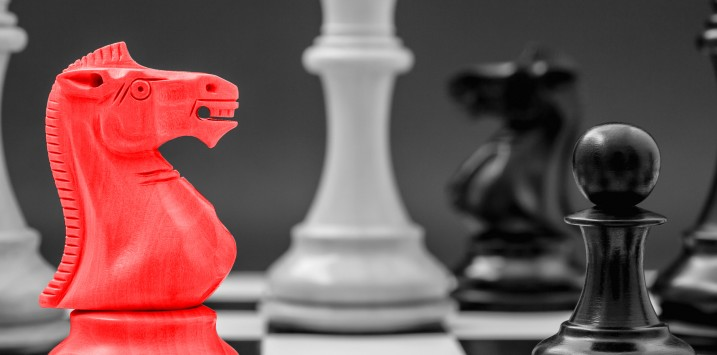 Black and White King and Knight of chess setup on Chessboard and dark background . Leader and teamwork concept for success.