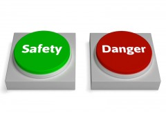 Danger Safety Buttons Showing Safe Or Harmful