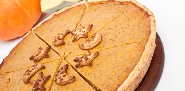 whole Pumpkin pie cut into slices