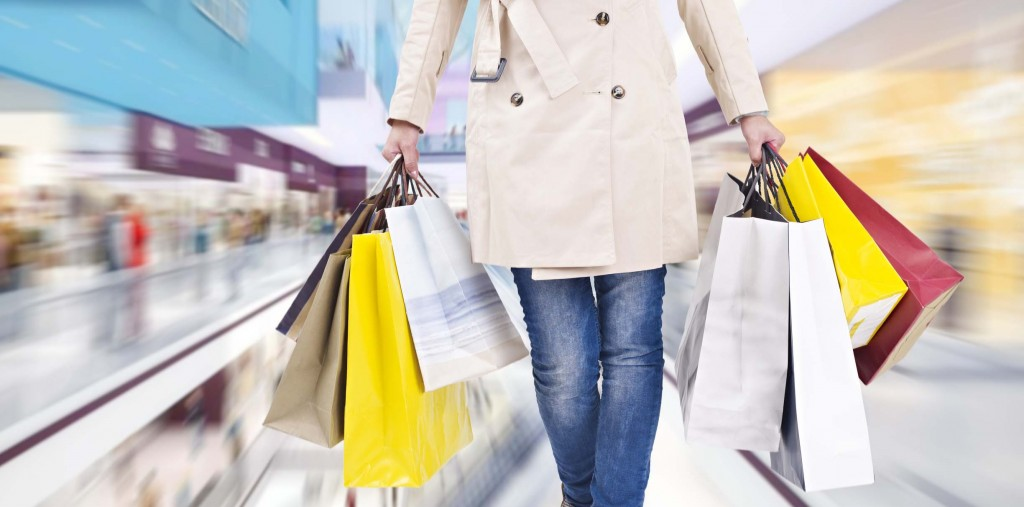 woman walking with shopping bags in mall.