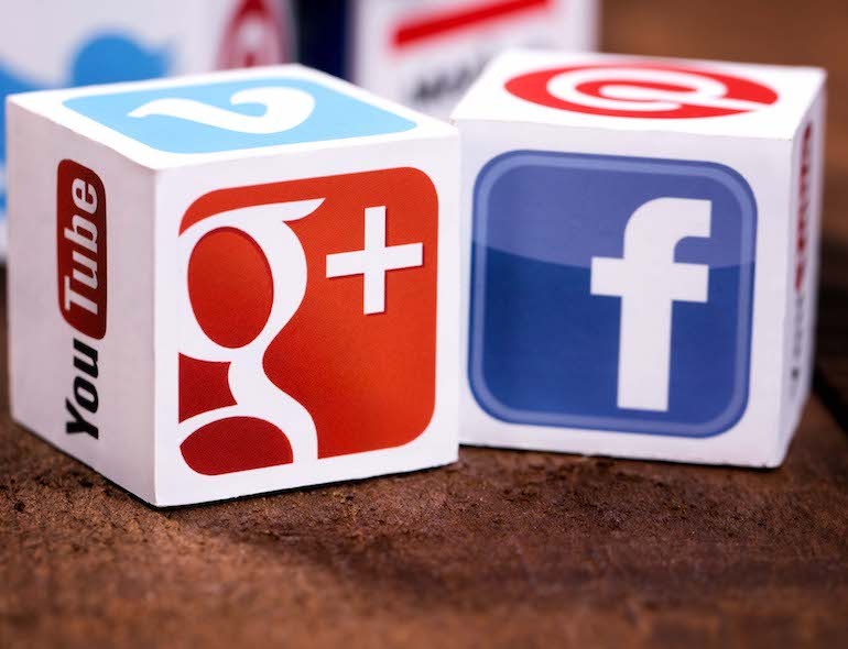 Sofia, Bulgaria - May 21, 2014: Social media logos printed onto handmade cubes. Logos include Facebook, instagram, linkedin, blogger. Social media uses web and mobile technology to connect people.