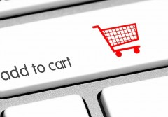 """An extreme close-up of a keyboard, focused on the shift key which now says """"add to cart"""" and has a red icon of a shopping cart. ***note to the reviewer: The  icon is my 100% original vector."""