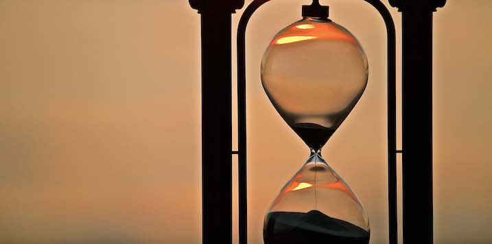 Hour Glass running with sunset background