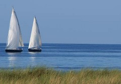 Two white sailboats on the sea