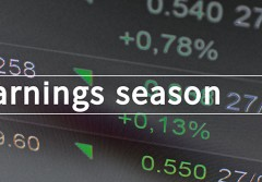 Earnings season written in search bar with the financial data visible in the background. Multiple exposure photo.